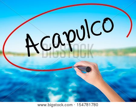Woman Hand Writing Acapulco  With A Marker Over Transparent Board