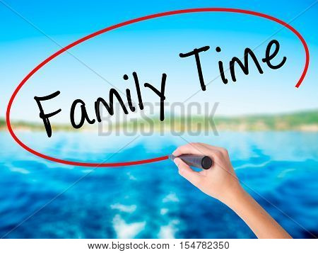 Woman Hand Writing Family Time With A Marker Over Transparent Board