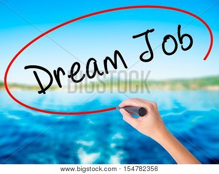 Woman Hand Writing Dream Job With A Marker Over Transparent Board