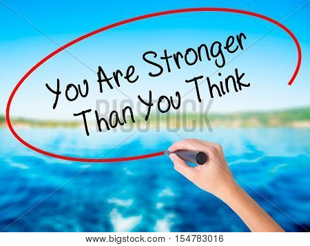 Woman Hand Writing You Are Stronger Than You Think With A Marker Over Transparent Board