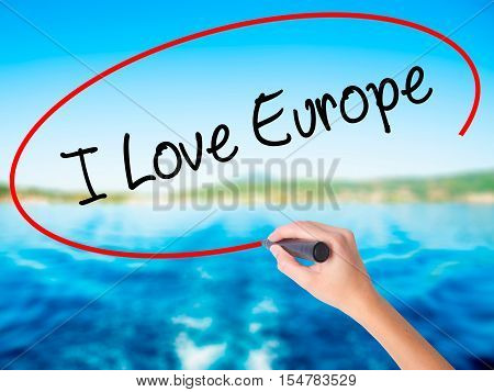 Woman Hand Writing I Love Europe With A Marker Over Transparent Board