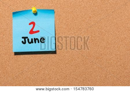 June 2nd. Day 2 of month, color sticker calendar on notice board. Summer time. Empty space for text.