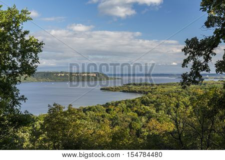 A scenic view of Lake Pepin on the Mississippi River during early autumn.