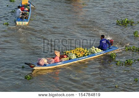 People With Wooden Boat On The River In Vietnam