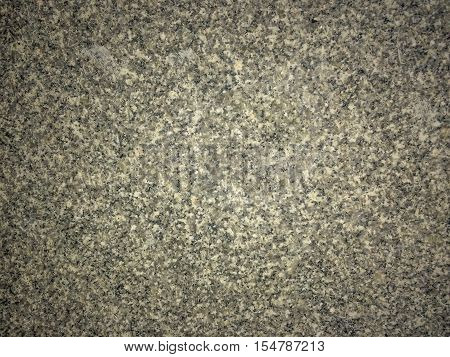 Dark granite stones texture background.Colorful flat rock