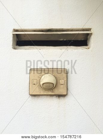 Old modern doorbell ring button with mailbox built-in on wall
