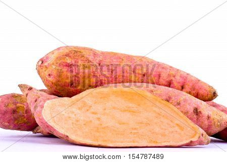 organic orange sweet potato yam and half sweet potato on white background healthy fruit food isolated