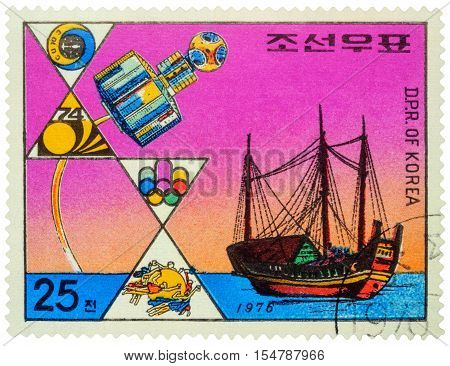 MOSCOW RUSSIA - NOVEMBER 02 2016: A stamp printed in DPRK (North Korea) shows ancient asian sailing ship (junk) and modern satellite circa 1976