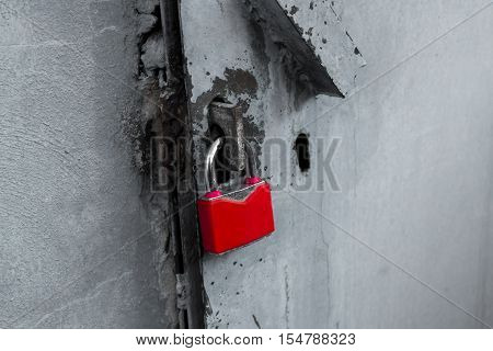 Padlock, new red padlock on gray background, red padlock