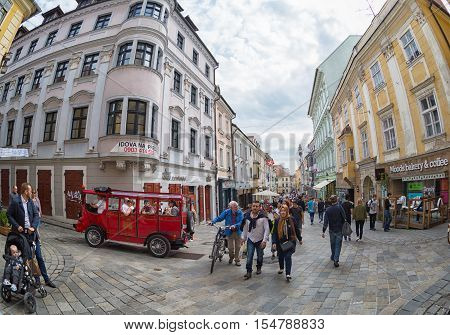 SLOVAKIA BRATISLAVA - APRIL 162016: Tourists and citizens on one of the pedestrian streets of Bratislava fisheye