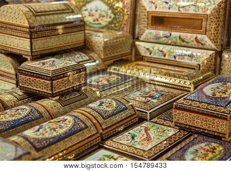 Wooden boxes with marquetry design in the form of Persian Khatam Inlay decorated with miniature paintings in Isfahan Iran.