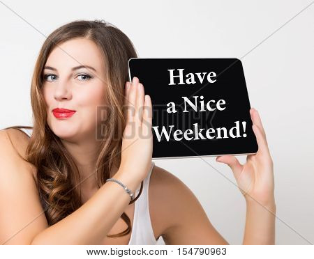 have a nice weekend written on virtual screen. technology, internet and networking concept. beautiful woman with bare shoulders holding pc tablet.