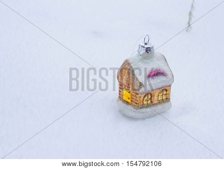 Christmas composition with small houses, Christmas trees and snow.