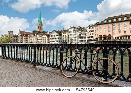 View of Zurich on Fraumunster Church and Church of St. Peter with bicycle in Zurich Switzerland.