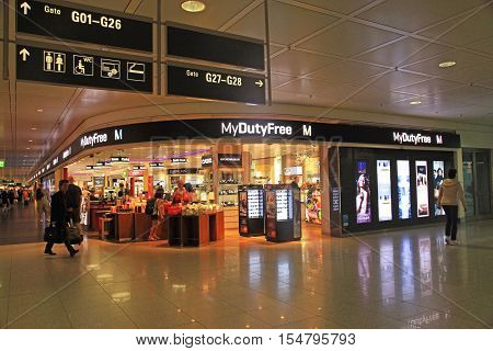 MUNICH, GERMANY - JULY 25, 2016: Duty free shop in Munich International Airport, Germany. The Munich Airport (MUC) Germany's second busiest airport is a major hub for Lufthansa (LH)