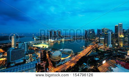 Aerial view of Singapore business district and city at night in Singapore Asia.