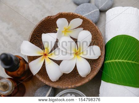 Composition of spa treatment on gray background