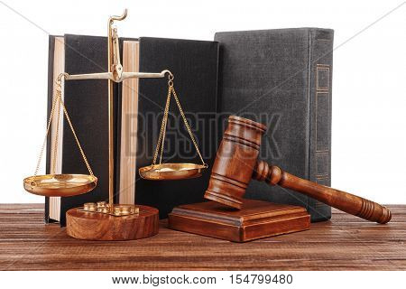 Gavel with books and scales on white background