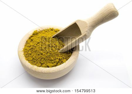 Curry in a wooden bowl and scoop on white isolated background