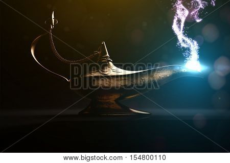 ancient magic lamp in dark place with glitters and stardust