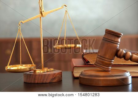 Justice scales, judges gavel and books on wooden table