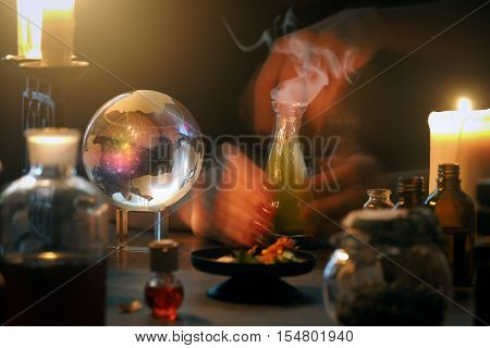 Witch at work mystical atmosphere a lot of magic items magic ball