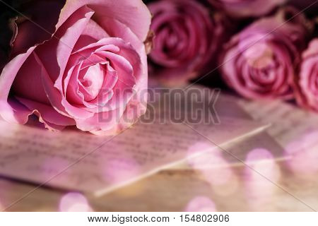Romantic decoration with a love letter and bokeh