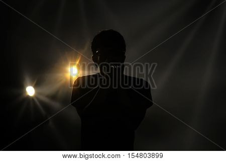 Blurred photo : Silhouette of pop singer.