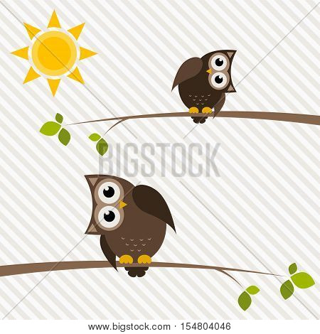 brown owl and owlet on the tree