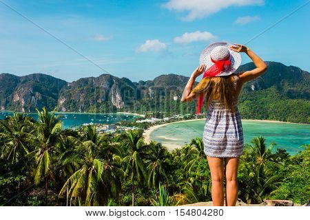 The Girl At The Resort In A Dress On The Background Of The Bays Of The Island Of Phi Phi