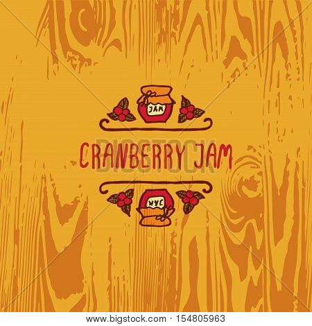 Hand-sketched typographic element with jam, berries and text on wooden background. Cranberry jam