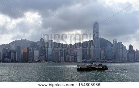 Hong Kong Oct 29 2016. Ferry at Victoria Harbor in Hong Kong. Skyline at Victoria Harbor Hong Kong. View from Kowloon on Hong Kong Island.