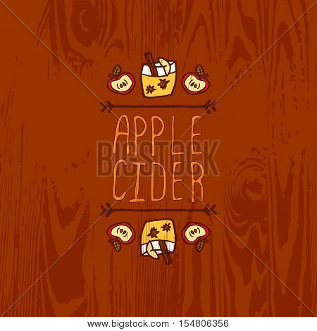 Hand-sketched typographic element with apple, apple cider and text on wooden background. Apple cider