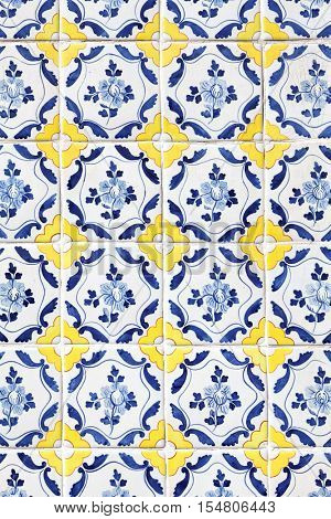 traditional Portuguese tiles (azulejos) from facade of old house in Lisbon, Portugal