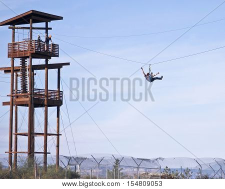 CAMP VERDE, ARIZONA, OCTOBER 13. The Out of Africa Wildlife Park on October 13, 2016, near Camp Verde, Arizona. A Man on the Zip Line at the Out of Africa Wildlife Park near Camp Verde Arizona.