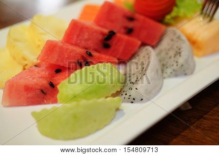 Close up slice of fresh fruitwatermelonguava and dragonfruit selective focus