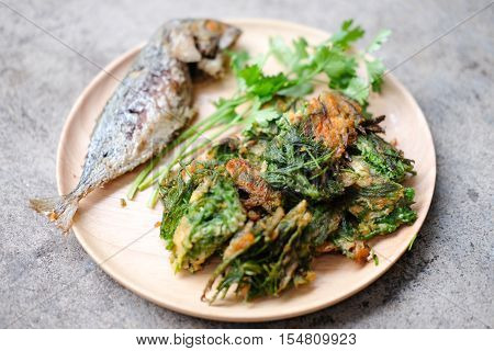 Fried Acacia Pennata Climbing Wattle with egg and fried mackerel (cha-om kai in Thai)