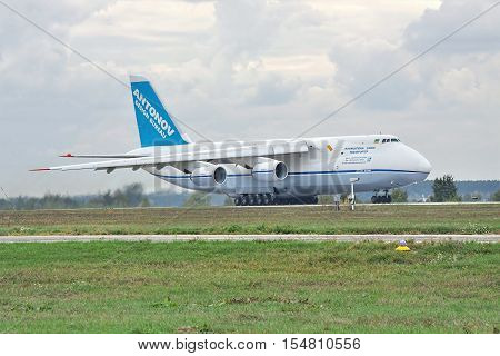 Kiev Region Ukraine - October 2 2010: Antonov Design Bureau An-124 cargo plane is taking off on a cloudy day