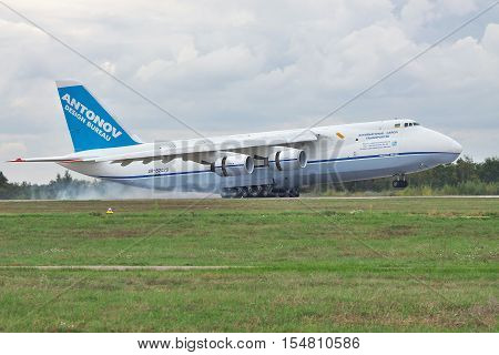 Kiev Region Ukraine - October 2 2010: Antonov Design Bureau An-124 cargo plane is landing with a massive touchdown smoke from its wheels