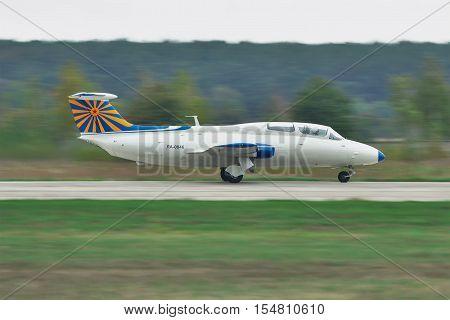 Kiev Region Ukraine - October 2 2010: Aero L-29 Delfin trainer plane is taking off for another flight - panning image shot