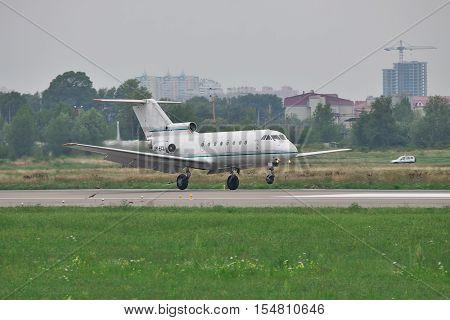 Kiev Ukraine - July 27 2011: Yakovlev Yak-40 regional passenger jet plane is landing and touchdownon a cloudy day