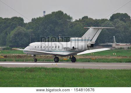 Kiev Ukraine - July 27 2011: Yakovlev Yak-40 regional passenger jet plane is taxiing along the runway after landing