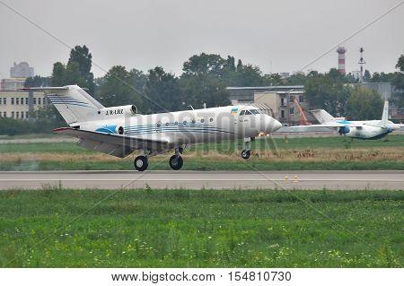 Kiev Ukraine - July 27 2011: Yakovlev Yak-40 regional passenger jet plane is landing on the runway in the airport
