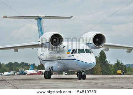 Kiev Region Ukraine - October 2 2010: Antonov An-74 cargo plane parked on the apron after a flight
