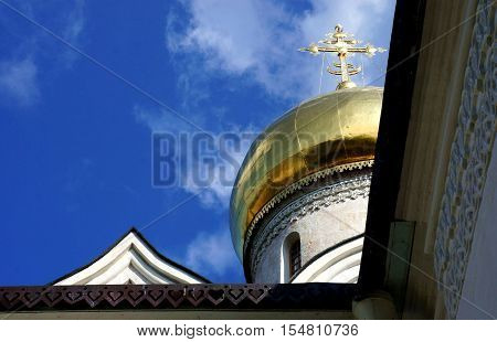 Savvino-Storozhevsky Monastery in Zvenigorod. Russian Orthodox monastery in Zvenigorod. Cathedral of the Nativity of the Mother of God the beginning of the XV century. The golden dome of the Russian Orthodox church on a background of blue sky.