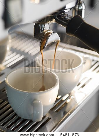 Espresso being made with a professional coffee machine.
