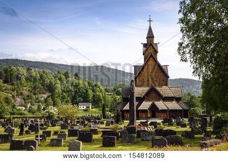 Old wooden stave church in Norway originated in medieval times when christianity was mixing with pagan Vikings