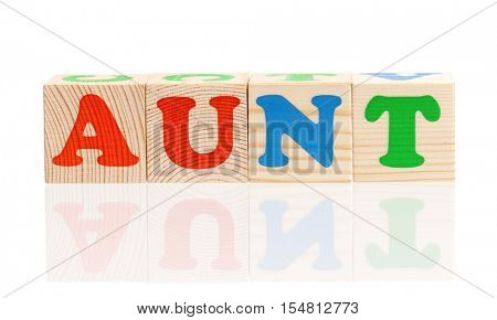 Aunt word formed by colorful wooden alphabet blocks, isolated on white background
