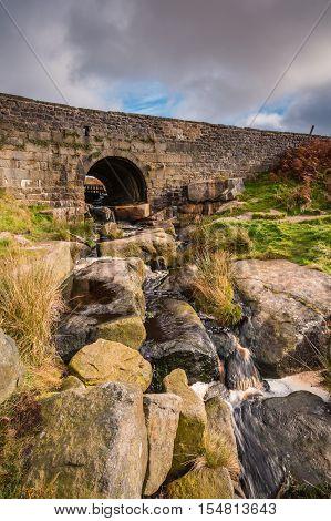 West Upper Burbage Bridge, with Burbage Brook flowing under it, located in the Peak District National Park