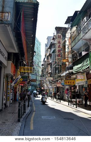 Macau China - Oct 28 2016. Narrow streets of Macau downtown. Macau is a popular tourist attraction of Asia in the holidays.